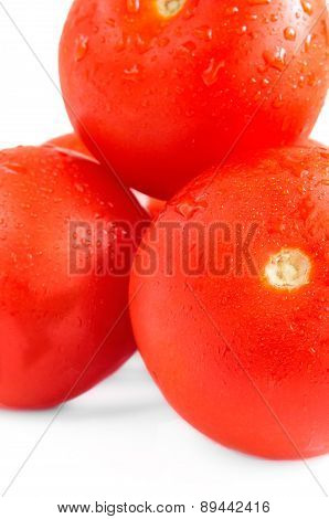Tomatoes With Water Drops On A White Background.