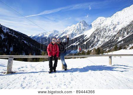 Happy Couple In Winter Landscape