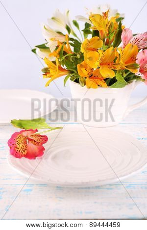 Table setting with flowers, closeup