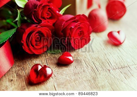 Roses and a hearts on wooden board