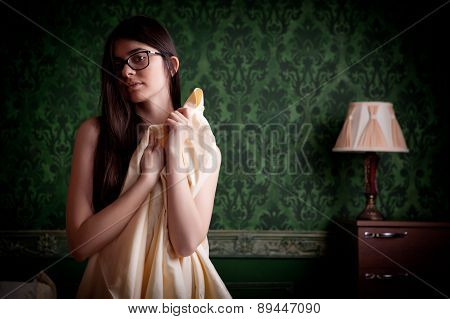 Sexy Naked Girl With Bed Sheets In Hands On Green Vintage Wall