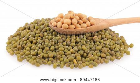 Soybeans In Wooden Spoon And Pile Of Mung Beans
