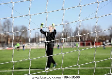 Image Of A Goalkeeper Through The Net
