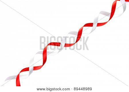 Colorful red and white ribbons isolated on white