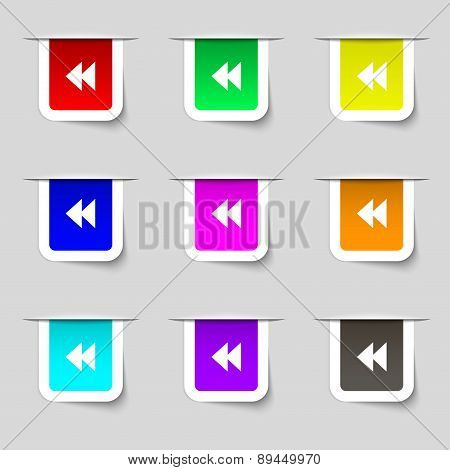 Rewind Icon Sign. Set Of Multicolored Modern Labels For Your Design. Vector