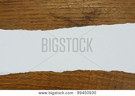 Torn Paper Against Wood Background