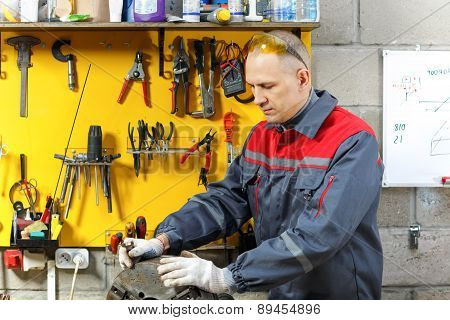 mechanic in  workplace makes repairs