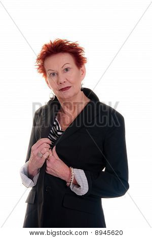 Older Woman With Wild Red Hair Wearing Black Jacket