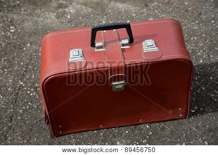 Vintage Leather Suitcase On Alley
