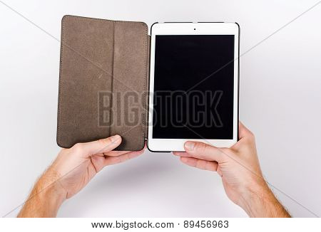 Hands with tablet computer, isolated on white background.