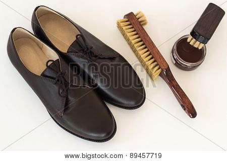 Isolated Brown Shoes And Means On Care Of Footwear - Shoe-polish And Brush