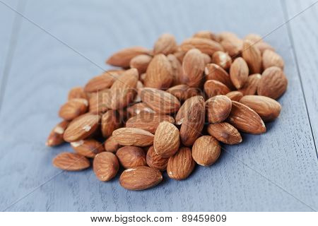 roasted almonds on blue wooden table