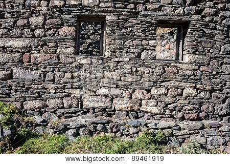 Stone Wall With Some Windows