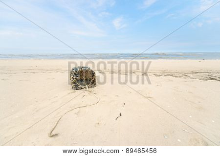 Empty lobster trap on the beach