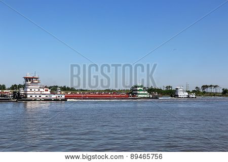 Three Tug Boats & Barge