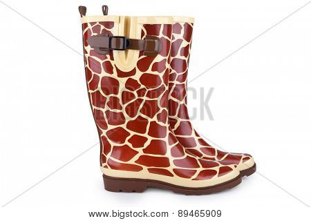 Gumboots with giraffe pattern isolated on white with shadow