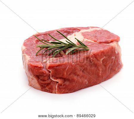 Beef Ribeye Steak Garnished With Sprig Of Rosemary