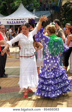 Spanish women flamenco dancing.