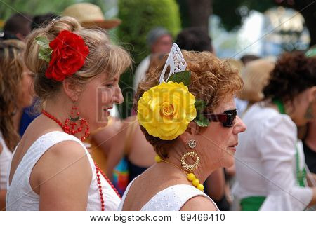 Spanish women with flowers in their hair.