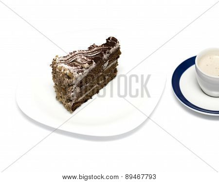 Chocolate Cake And Mug With A Cappuccino