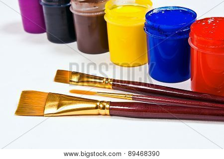 Bottles With Gouache Paints And Brushes For Artistic Paintings.
