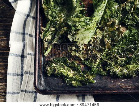 Crispy Cheese And Chili Kale Chips On Baking Tray.