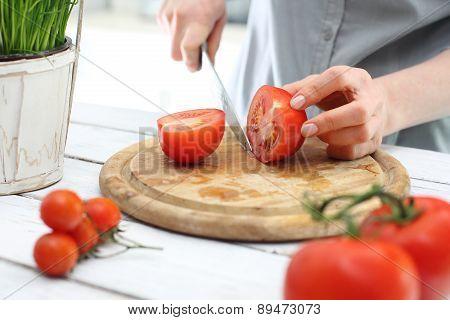 Tomato, woman preparing a meal
