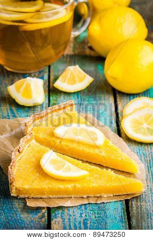 Two Pieces Of Lemon Tart With Slice Of Lemons