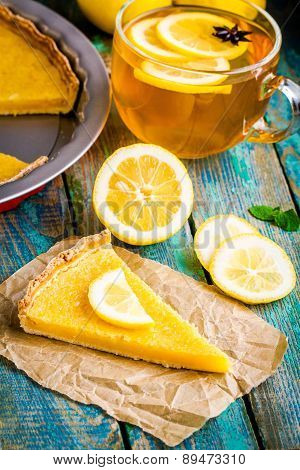 Piece Of Lemon Tart With Cup Of Tea