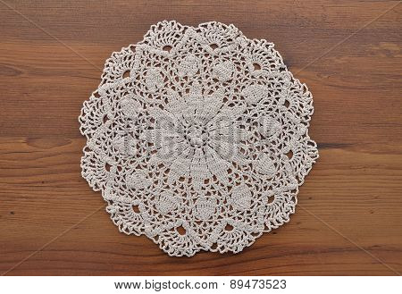 Lace Doily On Dark Wood
