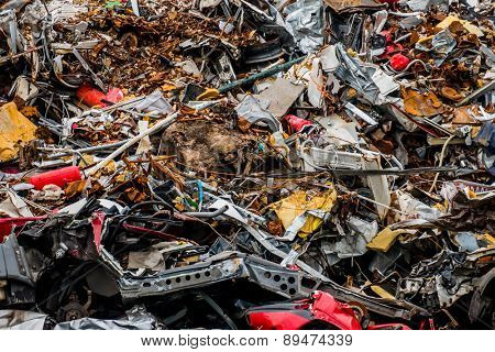 old cars were scrapped in a trash compactor. scrap iron and scrapping premium for car wrecks