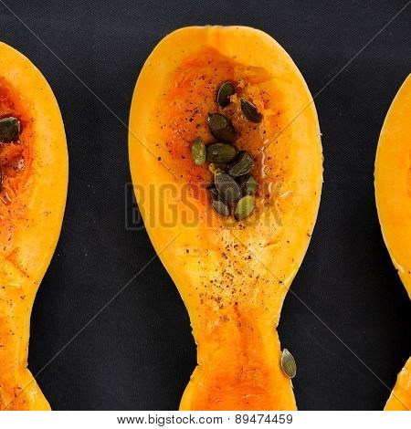 Butternut Squash Piece With Pumpkin Seeds On Black Background