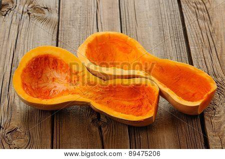 Halved Butternut Squash On Wooden Background