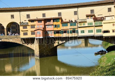 Florence italy two boats on the river bank