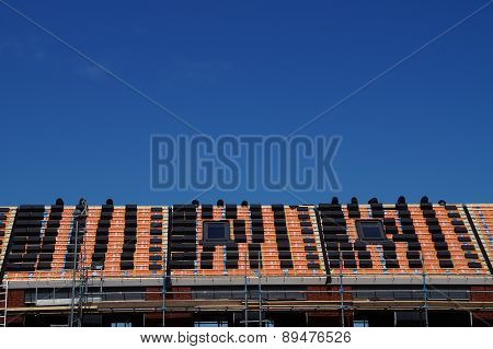 Placing roof tiles- roof construction