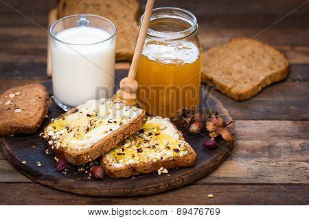 Healthy breakfast - bread, butter and honey