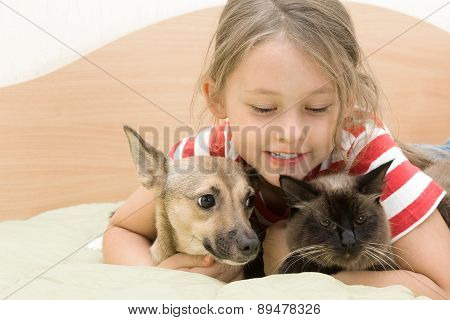Little Girl Tenderly Embraces Pets