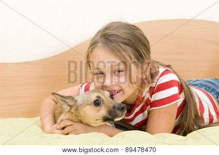 Girl Plays A Dog