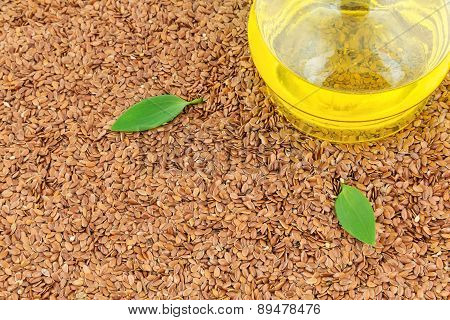 Flax Seeds And Glass Bottle Of Oil With Leaves