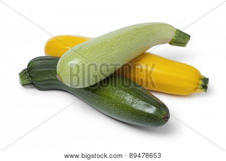 Fresh raw courgettes in different colors on white background