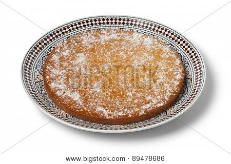 Fresh baked Moroccan yogurt cake on white background