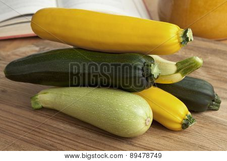 Pile of fresh raw courgettes in different colors