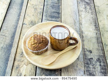 Banana Cup Cake And Milk On Wooden Background