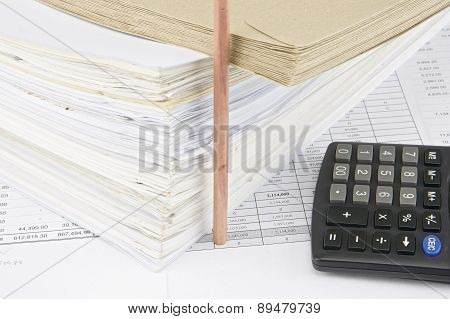 Envelope On Overload Old Paperwork With Vertical Pencil And Calculator