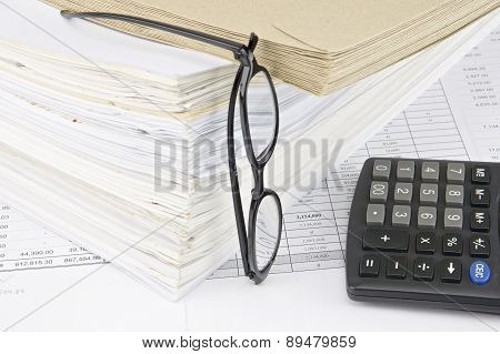 Envelope On Overload Old Paperwork With Vertical Spectacles And Calculator