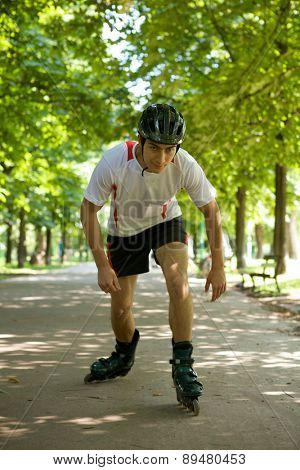 Young man riding roller skates