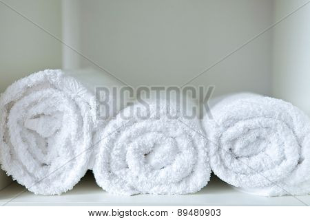 Close-up of rolled towels