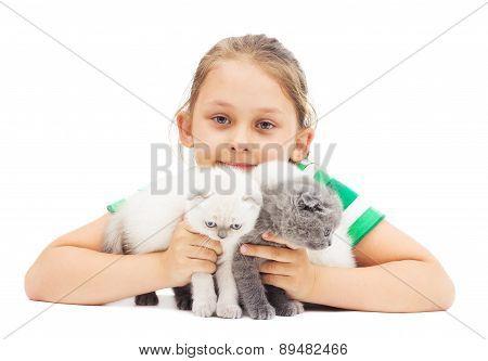 Kid Embraces Three British Lop-eared Kitten