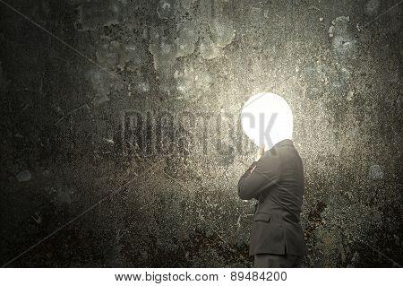 Thinking Businessman With Lamp Head Illuminated Dark Mottled Concrete Wall