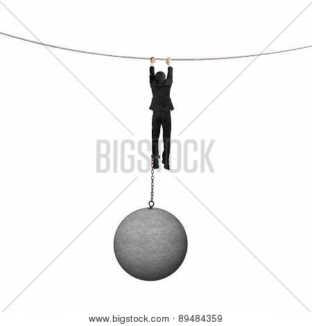 Businessman Shackled By Heavy Concrete Ball Hanging On The Rope